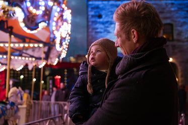 father and daughter watching lights