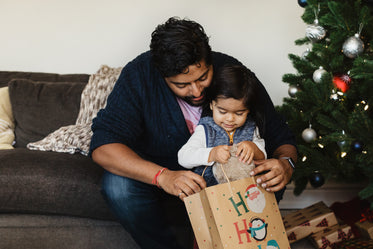 father and son open christmas gifts