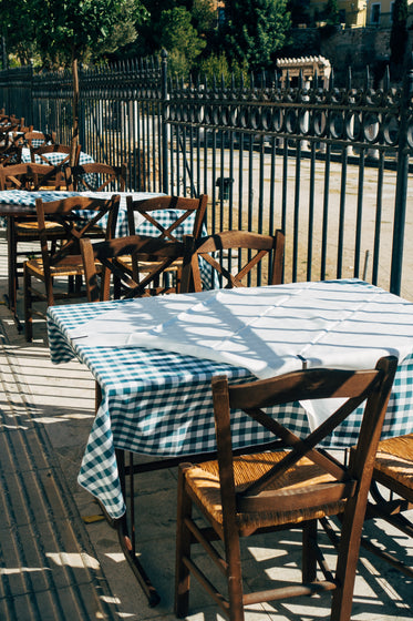 fence lined with patio tables and chairs