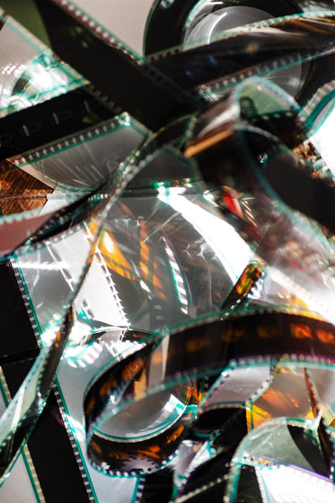film reel catches light tangled on a white surface