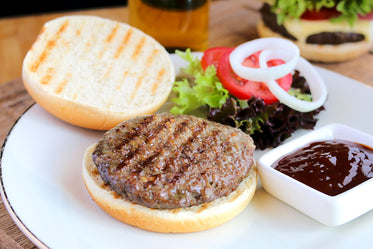 flame broiled hamburger with garnishes