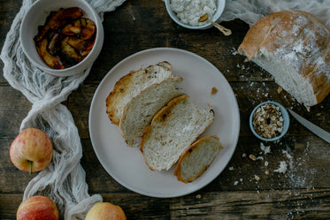 flat lay of baked bread with apples and oats