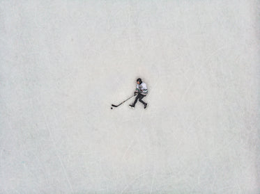 flat lay view of hockey player against the ice