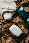 flatlay of soap and dried crispy leaves