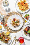flatlay of varied plated food on white plates
