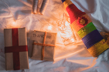 flay lay of gifts string lights and a bottle