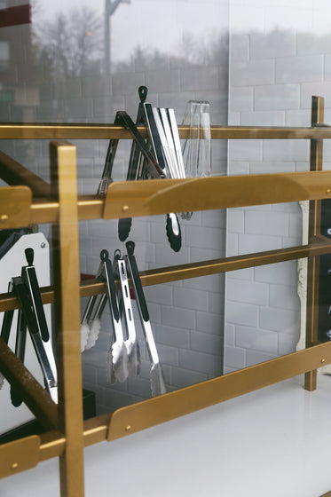 food tongs on a gold rack
