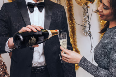 formal party pouring champagne
