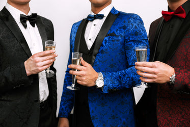 formal tuxedos in red black and blue