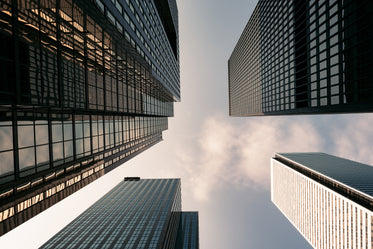 Browse Free HD Images of Four Buildings From Below Small Clouds