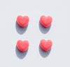 four hearts lay spaced out on a white background