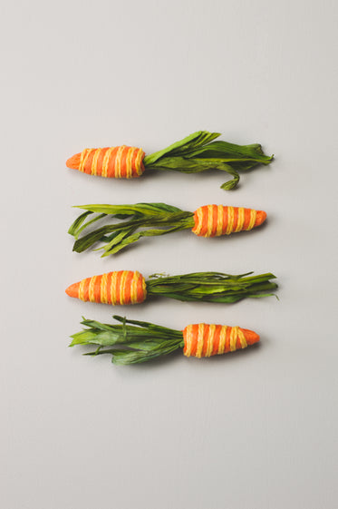 four paper crafted carrots