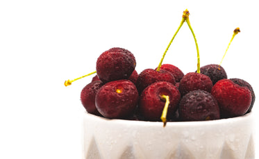 freshly washed cherries on display, off set to the right