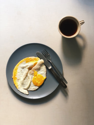 fried eggs and black coffee