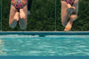 friends jump in pool together