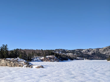 frozen lake covered in winter snow