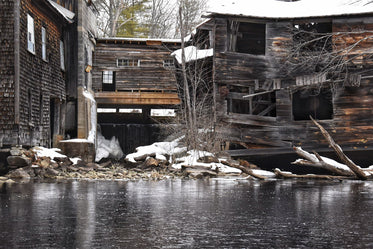 Frozen River Below Collapsed Wooden Building