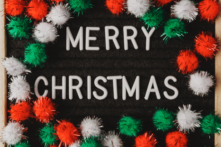 Fuzzy Decorations Surround The Words Merry Christmas