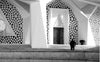 geometric entrance to a large mosque in black and white