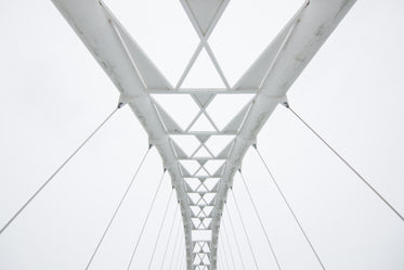 geometric walking bridge white sky