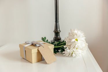 gift with flowers on bedside table