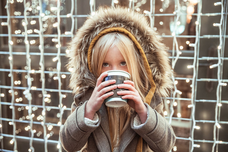 Girl Drinking Hot Beverage