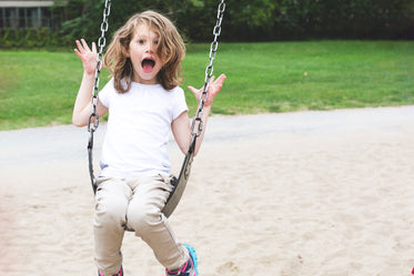 girl playing on park swings