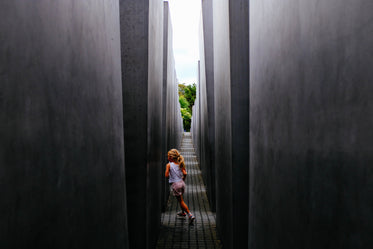girl plays in concrete structure