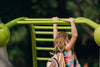girl swinging on bars with backpack