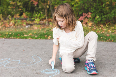girl using sidewalk chalk