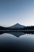 glassy lake reflects mount hood oregon