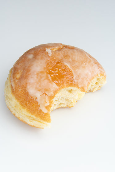 glazed doughnut with a few bites out of it