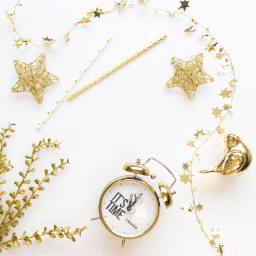 gold wire-frame stars, christmas decorations, and a clock.
