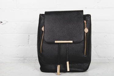 gold zipper on black fashion backpack