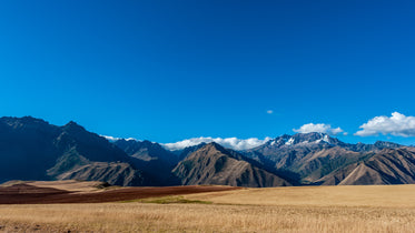 golden grasses and mighty mountains