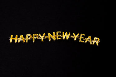 golden happy new year lettering