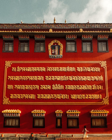 golden lettering on a red temple