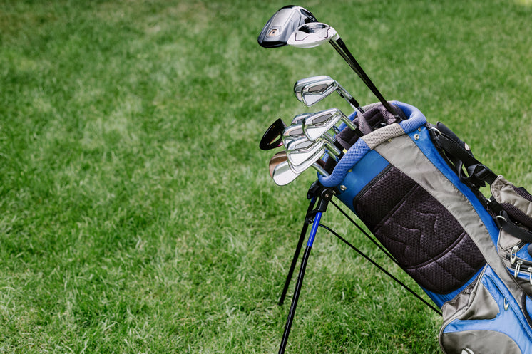 Golf Bag With Clubs At Golf Course