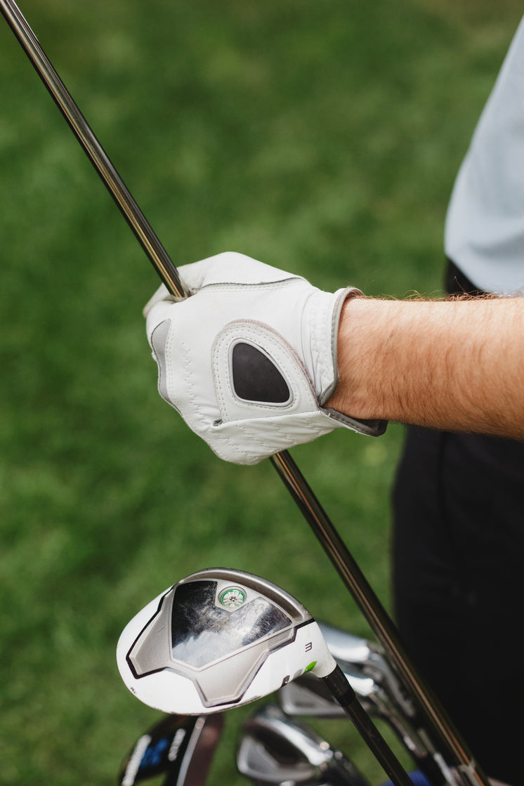 Golfer Holds Club With Gloves