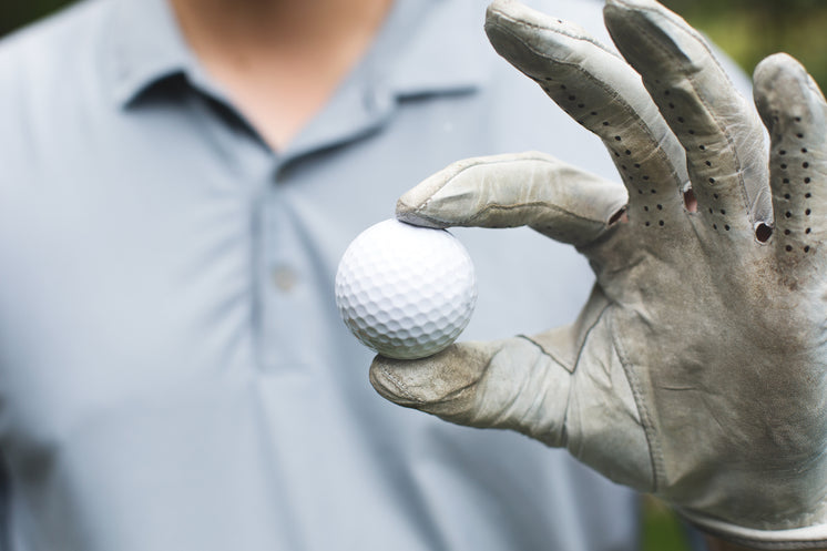 Golfer Holds Golf Ball