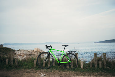 green bike by water