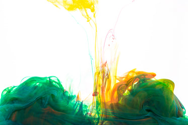 green ink with yellow and orange drop