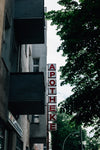 grey building with the word apotheke along the side