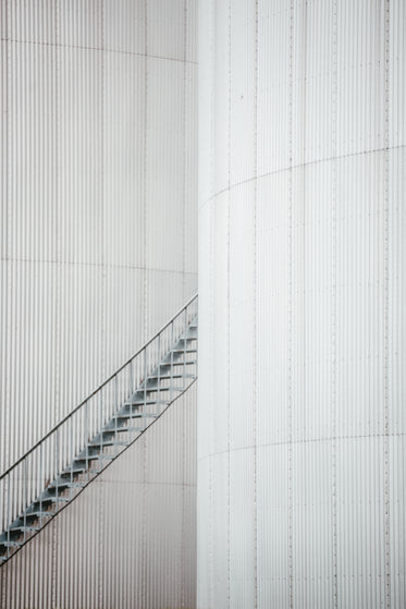 grey iron staircase between two buildings