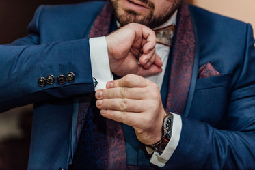 groom adjusting cufflinks