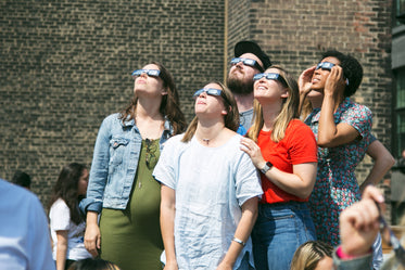 group watches eclipse