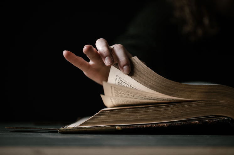 Hand Flips The Pages Of Book