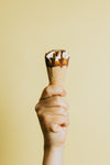 hand grips a chocolate dripped ice cream cone