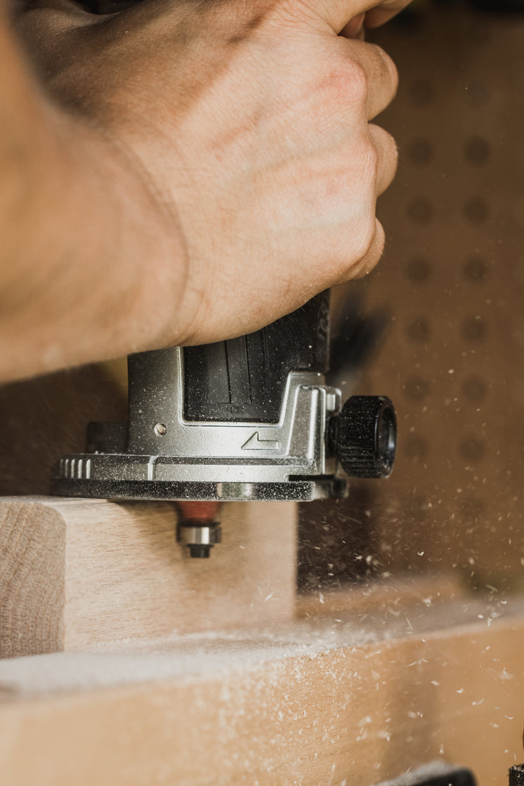 Hand-held Router Shaping Wood