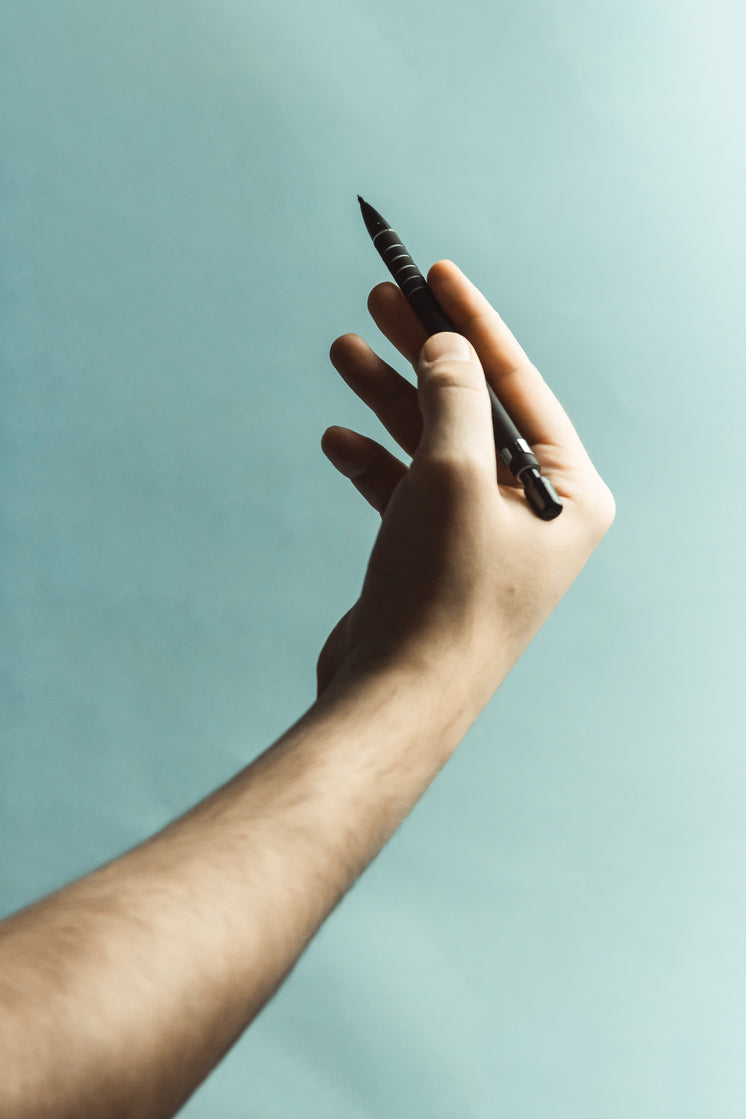 Hand Holding A Pen Photo